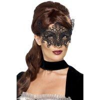 Umetelno okrašena črna maska